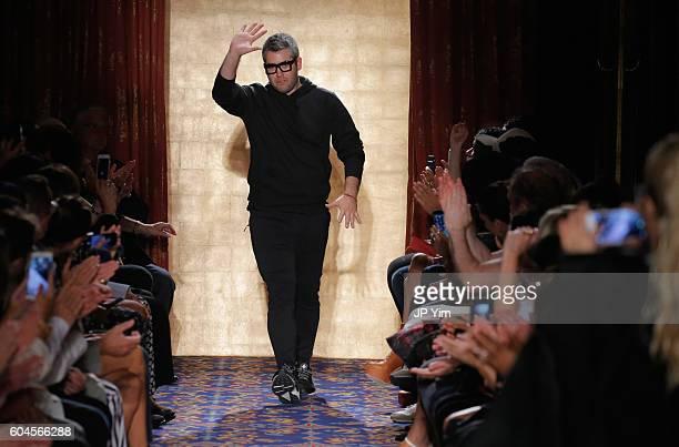 Brandon Maxwell walks the runway as Lady Gaga takes a photo during Brandon Maxwell's show at New York Fashion Week at Russian Tea Room on September...