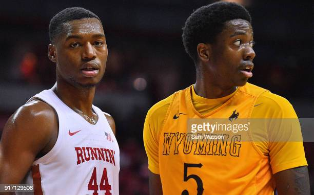 Brandon McCoy of the UNLV Rebels and Alan Herndon of the Wyoming Cowboys stand on the court during their game at the Thomas Mack Center on February...