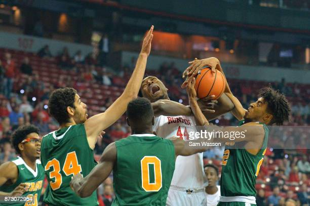 Brandon McCoy of the UNLV Rebels battles for a rebound against Isaiah Martin Desmond Williams and Marcus Barham of the Florida AM Rattlers during...