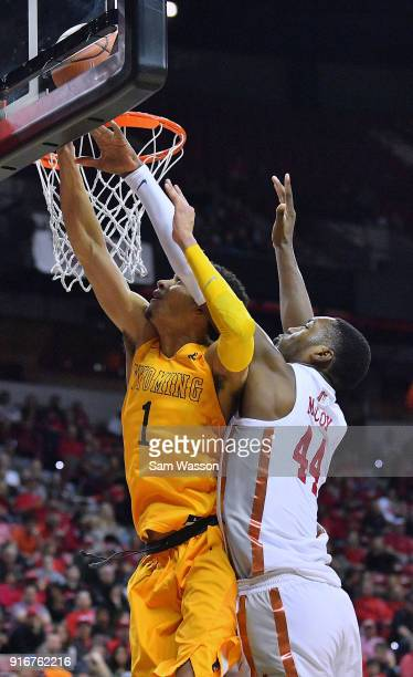 Brandon McCoy of the UNLV Rebels blocks a shot attempt from Justin James of the Wyoming Cowboys during their game at the Thomas Mack Center on...