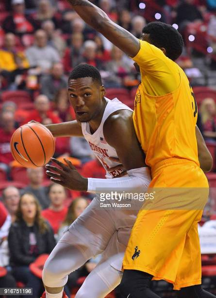 Brandon McCoy of the UNLV Rebels dribbles against Alan Herndon of the Wyoming Cowboys during their game at the Thomas Mack Center on February 10 2018...