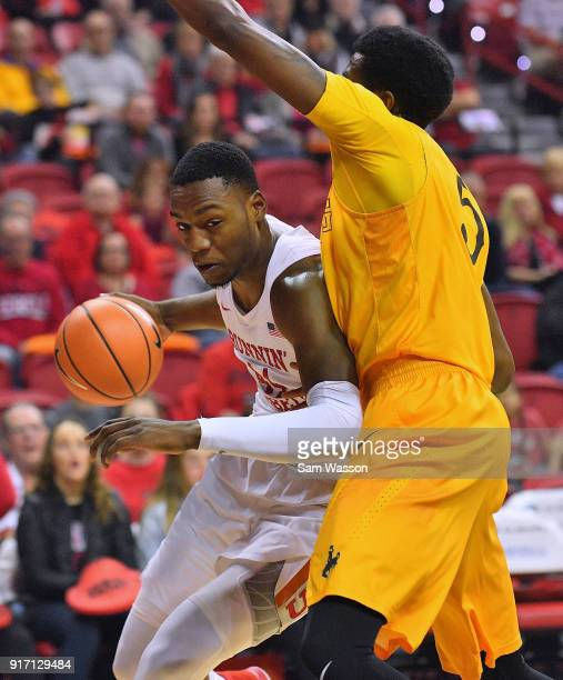 Brandon McCoy of the UNLV Rebels drives against Alan Herndon of the Wyoming Cowboys during their game at the Thomas Mack Center on February 10 2018...