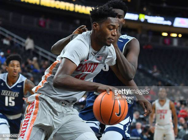 Brandon McCoy of the UNLV Rebels drives against Tim Harrison of the Rice Owls during day one of the Main Event basketball tournament at TMobile Arena...