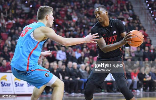Brandon McCoy of the UNLV Rebels drives agianst Vladimir Pinchuk of the New Mexico Lobos during their game at the Thomas Mack Center on January 17...