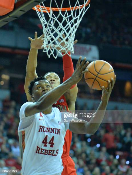 Brandon McCoy of the UNLV Rebels drives in for a layup against Ira Lee of the Arizona Wildcats during their game at the Thomas Mack Center on...