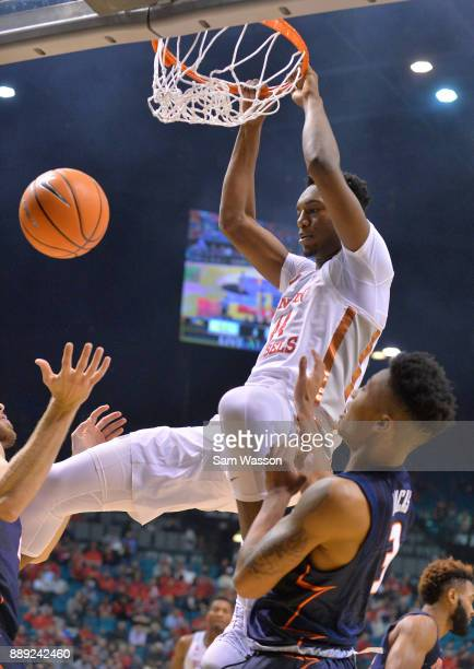 Brandon McCoy of the UNLV Rebels dunks against Te'Jon Lucas of the Illinois Fighting Illini during their game at the MGM Grand Garden Arena on...
