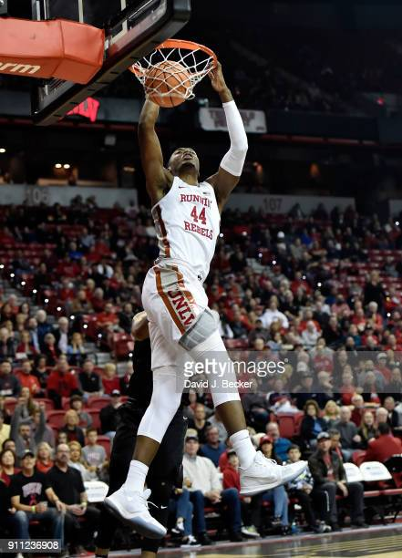 Brandon McCoy of the UNLV Rebels dunks the ball against Matt Mitchell of the San Diego State Aztecs during their game at the Thomas Mack Center on...