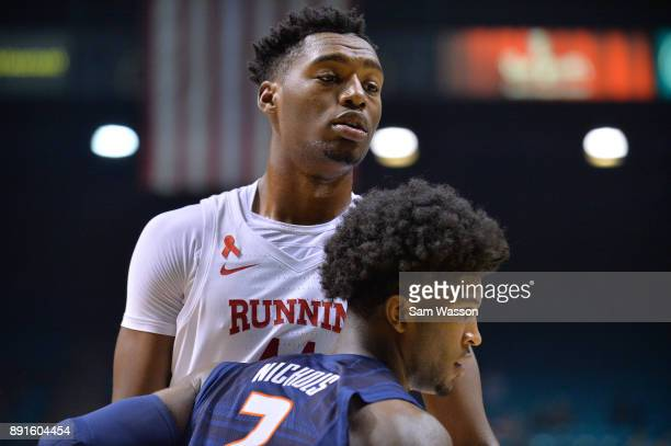 Brandon McCoy of the UNLV Rebels is guarded by Kipper Nichols of the Illinois Fighting Illini during their game at the MGM Grand Garden Arena on...