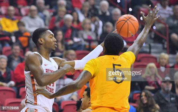 Brandon McCoy of the UNLV Rebels passes against Alan Herndon of the Wyoming Cowboys during their game at the Thomas Mack Center on February 10 2018...