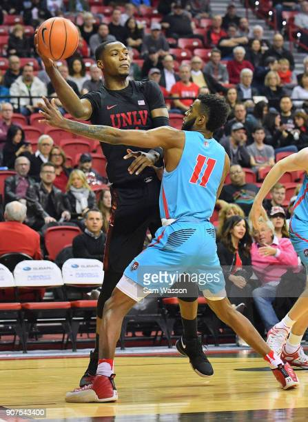 Brandon McCoy of the UNLV Rebels passes against Jachai Simmons of the New Mexico Lobos during their game at the Thomas Mack Center on January 17 2018...