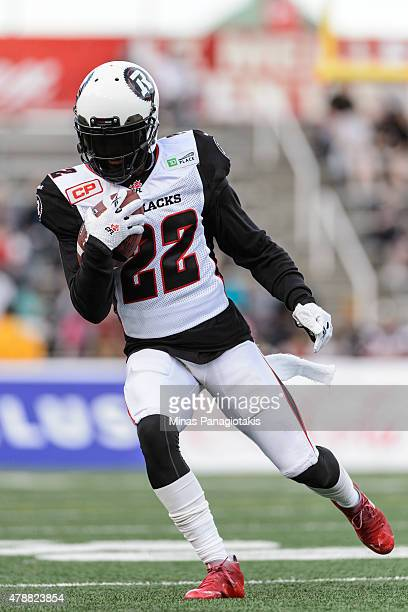 Brandon McDonald of the Ottawa Redblacks runs with the ball during the warmup prior to the CFL game against the Montreal Alouettes at Percival Molson...