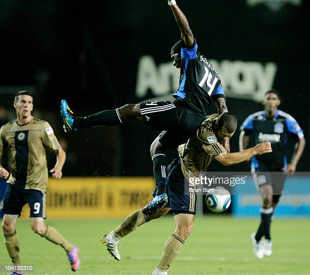 Brandon McDonald of the San Jose Earthquakes falls back on Alejandro Moreno of the Philadelphia Union after going for a header in the first half on...
