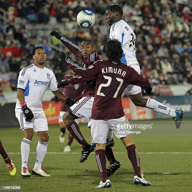 Brandon McDonald of the San Jose Earthquakes heads the ball as Marvell Wynne and Kosuke Kimura of the Colorado Rapids defend during the MLS Eastern...