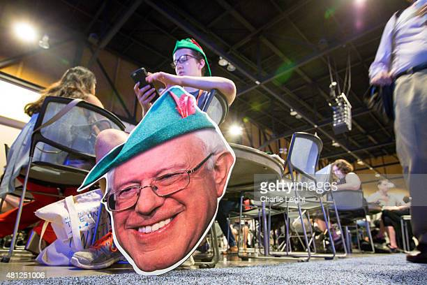 Brandon McKinna of Philadelphia hold modified Robin Hood face of US Sen Bernie Sanders while waiting for the start of the Netroots Nation 2015...