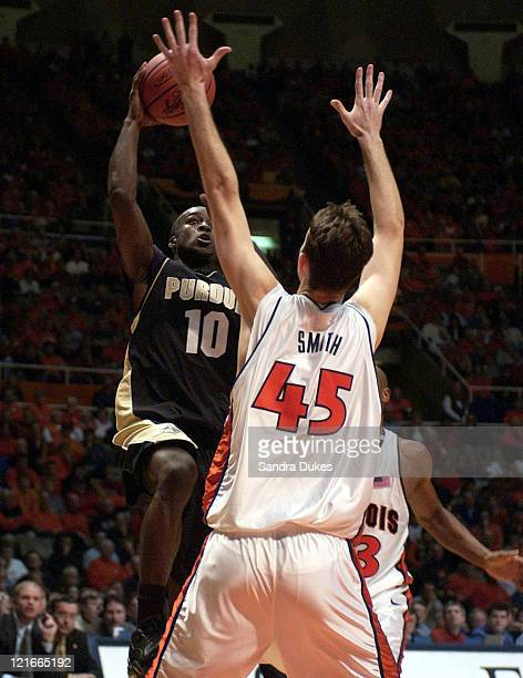 Brandon McKnight 10 goes up for 2 points over Nick Smith in Purdue's 5854 win over Illinois in Champaign Illinois January 10 2004