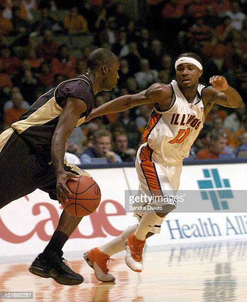Brandon McKnight brings the ball up the court aagainst Illinois' Dee Brown in the first half of Purdue's 5854 win in Champaign Illinois January 10...