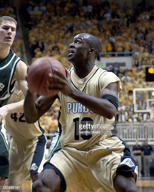 Brandon McKnight drives into Paul Davis to score the 2 points that sent the game in to overtime in Purdue's 7670 win