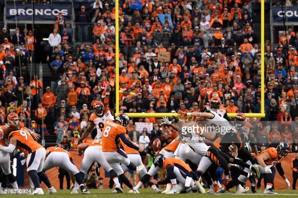 Brandon McManus of the Denver Broncos has a kick blocked during the second quarter against the Cincinnati Bengals The Denver Broncos hosted the...