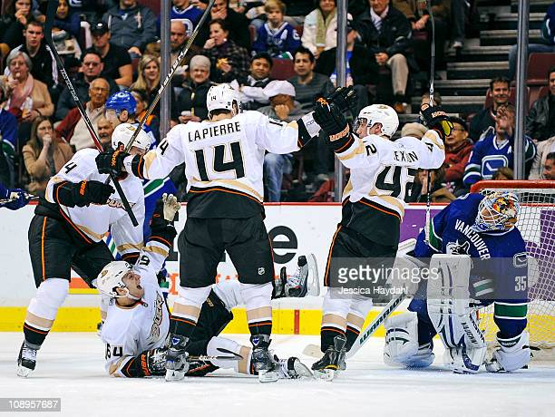Brandon McMillan celebrates his second period goal with teammates Maxime Lapierre Dan Sexton and Cam Fowler of the Anaheim Ducks while Cory Schneider...
