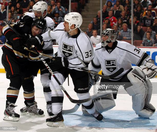 Brandon McMillan of the Anaheim Ducks battles outside the crease against Willie Mitchell of the Los Angeles Kings during the game on November 17 2011...
