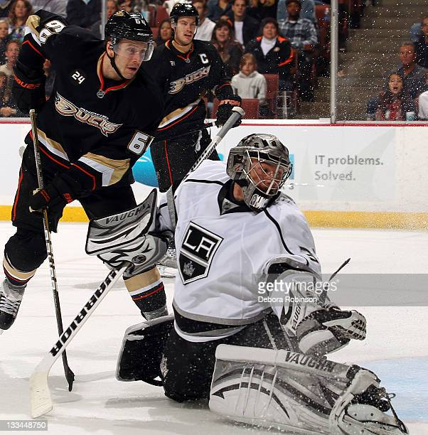 Brandon McMillan of the Anaheim Ducks defends outside the crease against Jonathan Quick of the Los Angeles Kings during the game on November 17, 2011...