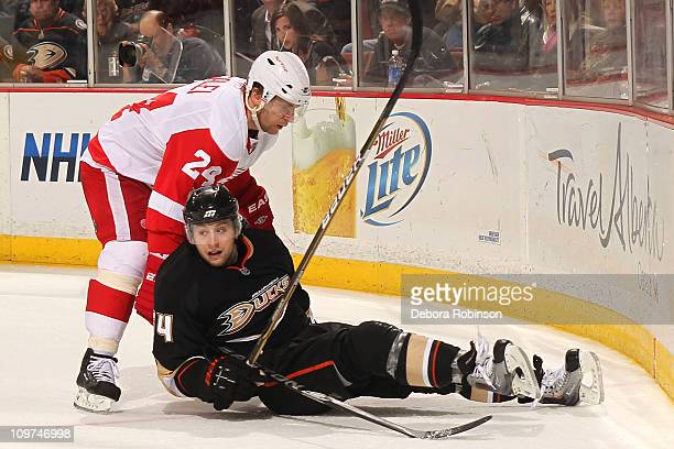 Brandon McMillan of the Anaheim Ducks falls to the ice defending against Ruslan Salei of the Detroit Red Wings during the game on March 2 2011 at...