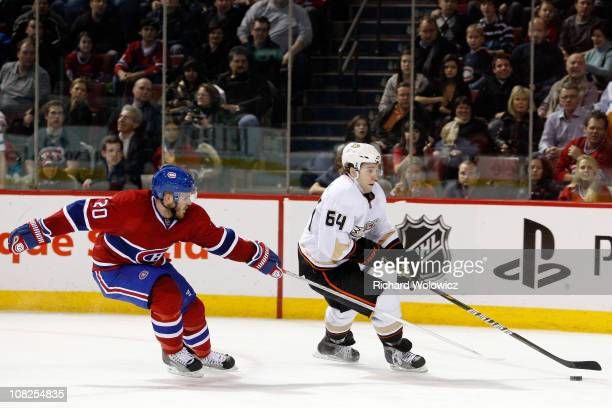 Brandon McMillan of the Anaheim Ducks skates with the puck while being defended by James Wisniewski of the Montreal Canadiens during the NHL game at...