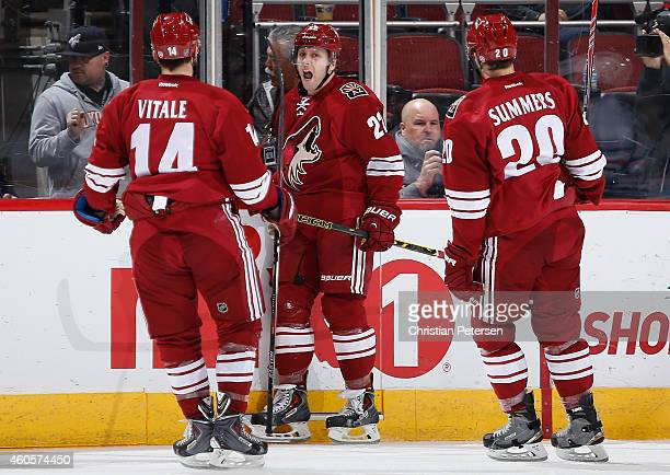 Brandon McMillan of the Arizona Coyotes celebrates with Joe Vitale and Chris Summers after scoring a second period goal against the Edmonton Oilers...