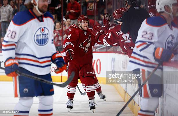 Brandon McMillan of the Arizona Coyotes celebrates with teammates on the bench after scoring a second period goal against the Edmonton Oilers during...