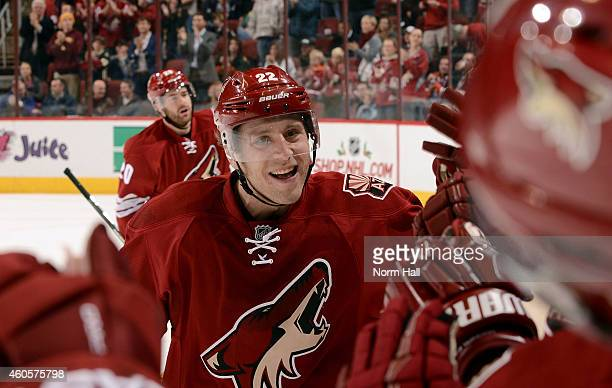 Brandon McMillan of the Arizona Coyotes is congratulated by teammates after his second period goal against the Edmonton Oilers at Gila River Arena on...