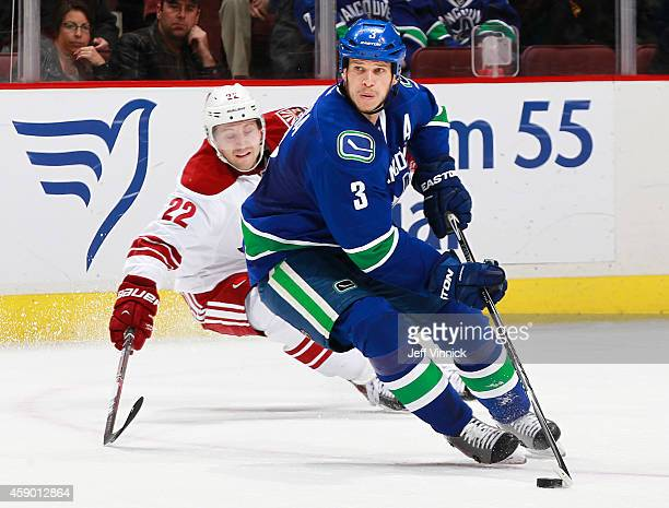 Brandon McMillan of the Arizona Coyotes pursues Kevin Bieksa of the Vancouver Canucks during their NHL game at Rogers Arena November 14, 2014 in...