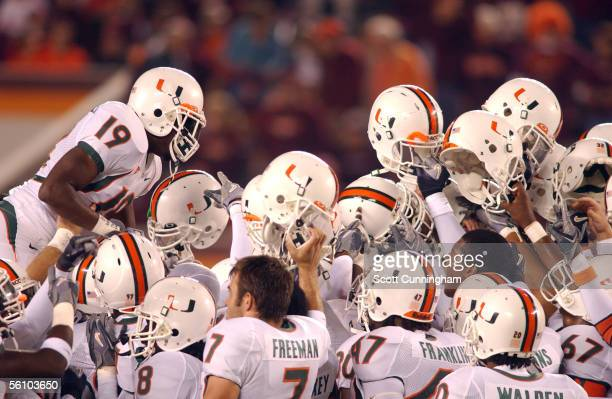 Brandon Meriweather of the Miami Hurricanes leaps onto a pregame huddle before the game against the Virginia Tech Hokies on November 5 2005 in...