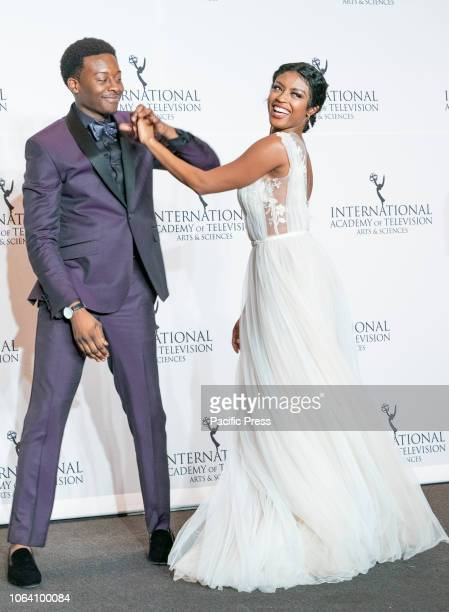 Brandon Micheal Hall and Javicia Leslie pose during the 46th International Emmy Awards at Hilton hotel