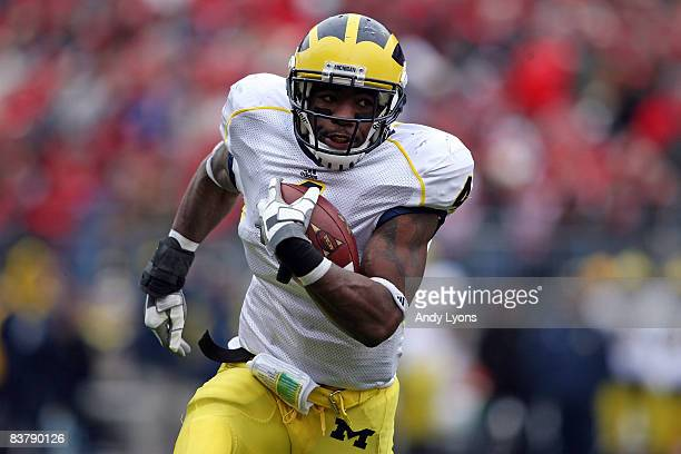 Brandon Minor of the Michigan Wolverine sruns with the ball during the Big Ten Conference game against the Ohio State Buckeyes at Ohio Stadium on...