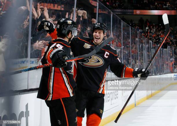 Brandon Montour and Ryan Getzlaf of the Anaheim Ducks celebrate Montour's thirdperiod goal against the Dallas Stars during the game at Honda Center...