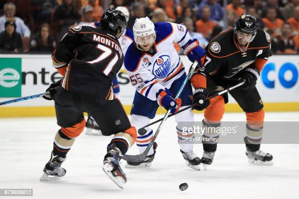 Brandon Montour and Ryan Kesler of the Anaheim Ducks defend against Mark Letestu of the Edmonton Oilers in the second period in Game One of the...
