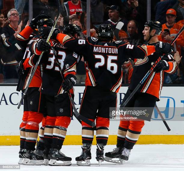 Brandon Montour Jakob Silfverberg and Ryan Getzlaf of the Anaheim Ducks celebrate a second period goal in Game Two of the Western Conference First...