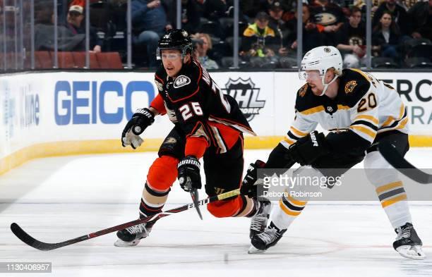 Brandon Montour of the Anaheim Ducks battles against Joakim Nordstrom of the Boston Bruins during the game on February 15 2019 at Honda Center in...