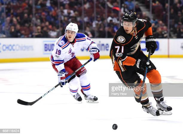 Brandon Montour of the Anaheim Ducks breaks past Jesper Fast of the New York Rangers during the first period at Honda Center on March 26 2017 in...