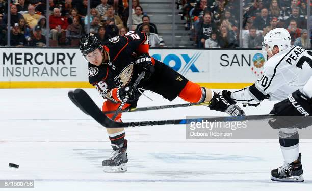 Brandon Montour of the Anaheim Ducks dumps the puck with pressure from Tanner Pearson of the Los Angeles Kings during the game on November 7 2017 at...