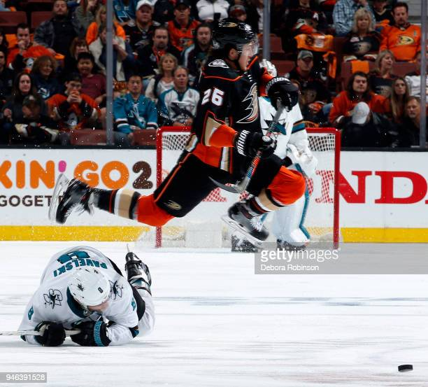 Brandon Montour of the Anaheim Ducks gets tripped up by Joe Pavelski of the San Jose Sharks in Game Two of the Western Conference First Round during...