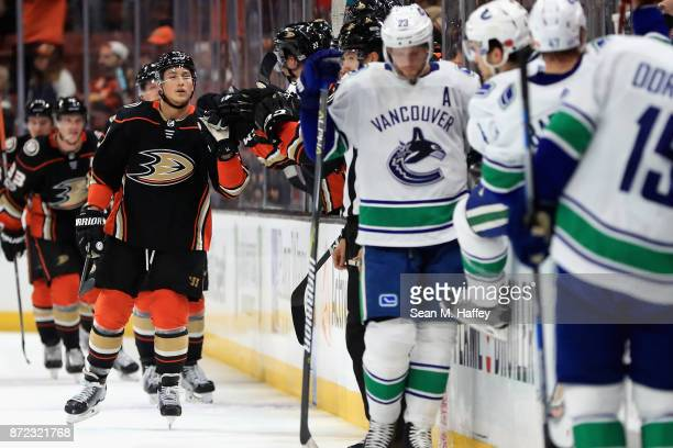 Brandon Montour of the Anaheim Ducks is congratulated at his bench after scoring a goal during the second period of a game against the Vancouver...
