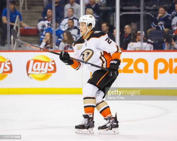 Brandon Montour of the Anaheim Ducks keeps an eye on the play during first period action against the Winnipeg Jets at the Bell MTS Place on February...