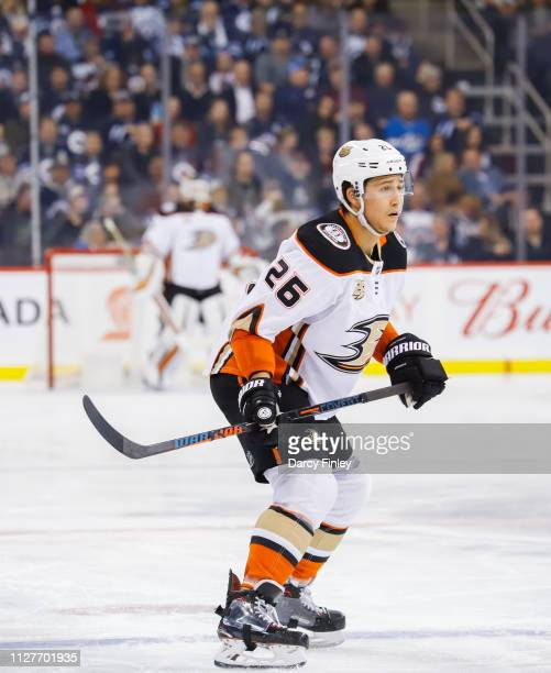 Brandon Montour of the Anaheim Ducks keeps an eye on the play during third period action against the Winnipeg Jets at the Bell MTS Place on February...