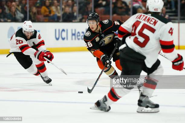 Brandon Montour of the Anaheim Ducks looks for a pass as Blake Coleman of the New Jersey Devils and Sami Vatanen of the New Jersey Devils play...