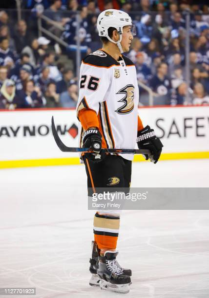 Brandon Montour of the Anaheim Ducks looks on during a second period stoppage in play against the Winnipeg Jets at the Bell MTS Place on February 2...