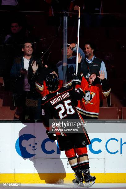 Brandon Montour of the Anaheim Ducks passes his stick to a fan following a 30 win over the Vancouver Canucks on March 14 2018 at Honda Center in...