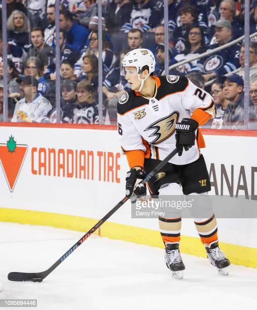 Brandon Montour of the Anaheim Ducks plays the puck along the boards during first period action against the Winnipeg Jets at the Bell MTS Place on...