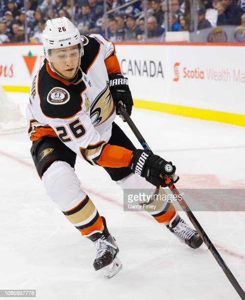 Brandon Montour of the Anaheim Ducks plays the puck along the boards during third period action against the Winnipeg Jets at the Bell MTS Place on...