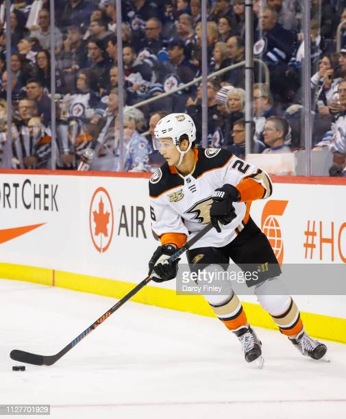 Brandon Montour of the Anaheim Ducks plays the puck during third period action against the Winnipeg Jets at the Bell MTS Place on February 2 2019 in...